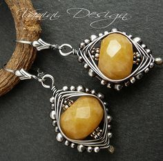 excellent wire wrapping to showcase two big druzy style beads. Note the smaller beads on the outermost wire wrap: makes it resemble a bezel of solid metal.
