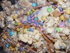 Bunny bait....Pop a bag of white popcorn and place on a cookie sheet. Add 2C of straight pretzels and 2C of rice chex cereal. Melt a bag of white chocolate pieces and pour over the mixture. Mix well. Let cool. When cool, break into pieces and add pastel Easter m's. Package in small bags.