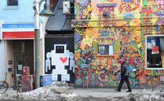 A painted lovebot about person height on a wall beside Lee's Palace on Bloor St - a building that is covered with intricate bright coloured pictures Bright Colors, Palace, Robot, Toronto, Times Square, Building, Wall, Pictures, Painting