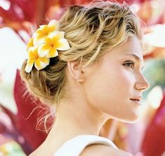 Adding a flower instantly adds flair to an easy updo.