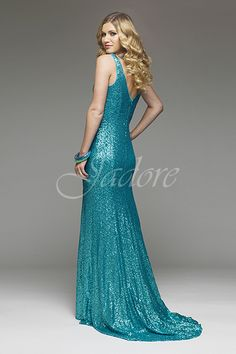 J4023 in Aqua all over beaded fabric with V neckline and back for prom.  Available in sizes 2 - 30 www.jadoreevening.ca for a full listing of boutiques that carry our collections in Canada contact us directly for USA boutiques!