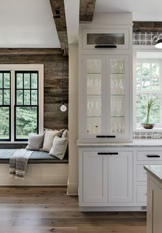 Crisp Architects renovated this colonial home with a modern farmhouse aesthetic, located in Chappaqua, New York. Glass Shelves Kitchen, Kitchen Display, Glass Kitchen, Kitchen Reno, Kitchen Remodeling, Kitchen Ideas, Kitchen Design, Cozy Living Spaces, Built In Bench