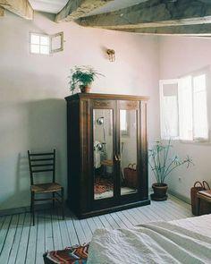 Beautiful vintage storage armoire in bedroom