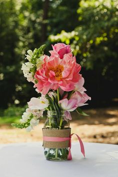 simple centerpiece idea using a recycled glass jar, burlap and ribbon   Love the idea a little touch of lace and a change of color in the flowers and we're good.