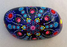 """Beautiful hand painted dots mandala. These unique creations use acrylic paint. I hand craft designs and finishes to the sea stones. Measurements : 5.9 x 3.9 - 15 x 10 cm approx. Weight :650G Background colour: navy blue  The stones are perfect used as a paper weight, or for decorating a special space as well as for meditation. Amazing gift for those friends or colleagues who has """"everything"""".  If you would like to see more painted stones, please have a look following those links…"""