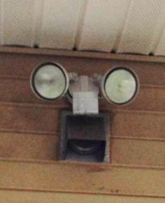This is the automatic security light on the back of our house. Things With Faces, Solar Security Light, Hidden Face, Natural Face, Light Installation, Everyday Objects, Urban Landscape, Solar Lights, Funny Faces
