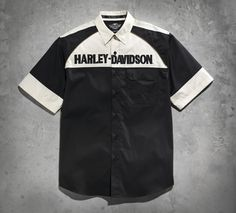 What's black and white and awesome all over? This shirt featuring this season's sleek winged skull graphics. The colorblocked yoke and sleeve design add retro style. | Harley-Davidson Men's Winged Skull Colorblocked Woven Shirt