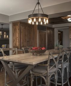 Instead of a breakfast table, an extended island with stool seating was designed for this family. The countertop is a gorgeous matte blonde walnut. Walnut Countertop, Wood Countertops, Outdoor Tables, Outdoor Decor, Custom Kitchens, Rustic Table, Walnut Wood, Rustic Design, Beautiful Interiors