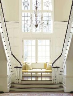 Gorgeous two-story split-staircase...Beauty & The Beast?