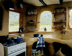 Earthbag Kitchen. Love built in storage...a little too slanted for my liking..but could work on it.