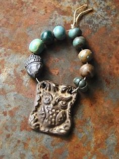 Woodland Friend … These hand formed ceramic beads and Owl and Leaf pendant are glazed in earthy forest colors by Gaea Cannaday.