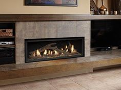 The 4415 HO gas fireplace brings you the very best in home heating and style with its sleek, linear appearance and impressively high heat ou. Stone Tile Fireplace, Fireplace Facade, Fireplace Tile Surround, Linear Fireplace, Fireplace Inserts, Modern Fireplace, Fireplace Surrounds, Fireplace Design, Off Center Fireplace