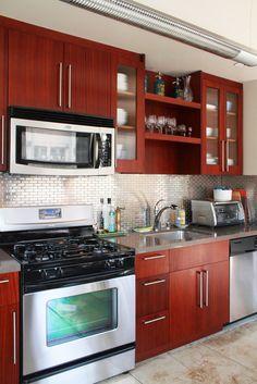 Gorgeous cherry cabinets with stainless steel backsplash! Kitchen And Bath, New Kitchen, Kitchen Dining, Kitchen Decor, Kitchen Ideas, Metal Tile Backsplash, Kitchen Backsplash, Kitchen Cabinets, Backsplash Ideas