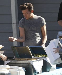 NEW HQ PIC: Louis inspecting his new tattoo backstage at X Fa... on Twitpic