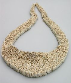 """The Hunting Food -  jewelry from the teeth of 125 rabbits, by Natalie Luder, Zurich   """"I made jewelry using the teeth of 125 rabbits. The central piece is the collar that bears the name '125 Lapins.' It is composed of 2500 knotted together posterior teeth. Necklaces and brooches were constructed from the naturally curved front teeth."""""""