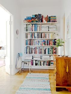 Small Space Secrets: Swap Your Bookcases for Wall Mounted ShelvingWall-mounted shelving systems, he points out, sit closer to the wall so, they take up less floor space. They can also hold more things than a traditional bookcase because you can install them all the way to the ceiling.  In the top image, from Stadshem via Freshhome, wall-mounted shelves maximize storage space at the end of a hallway.