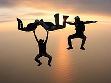 Parachuting, also known as skydiving,