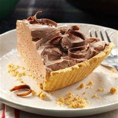 Chocolate Cheesecake Pie Recipe -Guests always go for this rich but simple pie. I like topping it with fresh raspberries or cherry pie filling. —Sandy Schwartz, Brooklyn, NY