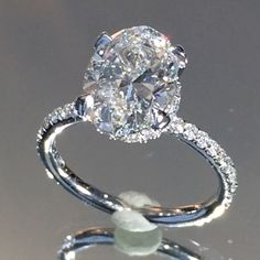 """Dream ring (but with FO moissanite), High quality video of the aforementioned #ovaldiamond ring made for our clients on the left coast. This seductive design showcases a delicate #micropave band with our perfectly placed diamond """"scarf"""" beneath the center."""