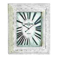 "Antique Style Distressed Wood Train Station Wall Clock with White Washed Thick Carved Frame  This wood wall clock features large numbers on the face with a distressed white washed wood thick beautifully carved wood. This wall clock is the perfect rustic addition to any modern space!  Overall Dimensions of This Wood Wall Clock: 28"" H x 23"" W"