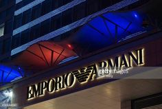 06-13 A logo sits illuminated outside an Emporio Armani luxury... #novytekov: 06-13 A logo sits illuminated outside an Emporio… #novytekov