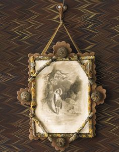 Use nature's raw materials to create a frame. Looks great with sepia or b&w photos!