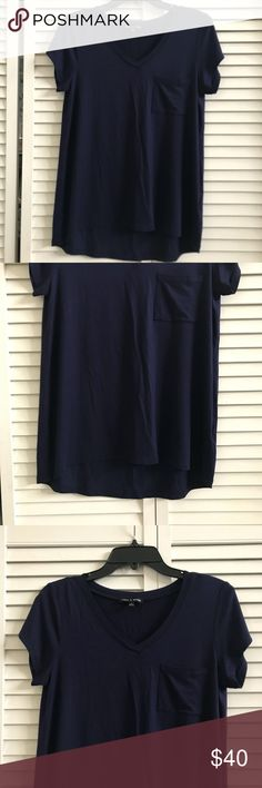 🎉Closet Clear Out! Re-posh blue tee, NWOT. Re-posh blue v-neck tee from the lovely closet of @bella4. First photo credit goes to @bella4. Soft. High low hem. V-neck. New without tags. Size medium. 95% viscose, 5% spandex. Smoke free home. Tops Tees - Short Sleeve