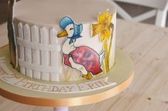 Peter Rabbit birthday cake with handpainted details , handwritten banner for a girl birthday by Lough Erne Cakes