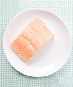 How to Poach Salmon: Season pieces of skinless salmon fillet with salt and pepper and place in a shallow microwave-safe baking dish with 2 tablespoons white wine vinegar or rice vinegar (to add flavor) and enough water to reach halfway up the fish. Cover and microwave on high (power level 10) until the fish is opaque throughout, 3 to 4 minutes. If the fish is not fully cooked, microwave, covered, on high in 45-second intervals. Remove from liquid and serve.