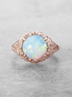 Iridescent rainbows with fiery flashes can be seen in the domed Gem of our Precious Shimmering Opal ring. Clasped in a bouquet of beautiful delicate flowers, and named for the divine goddess of flora, Opal Jewelry, Sterling Silver Jewelry, Jewelry Rings, Jewlery, Jewelry Box, Cute Jewelry, Modern Jewelry, Flower Jewelry, Walmart Jewelry