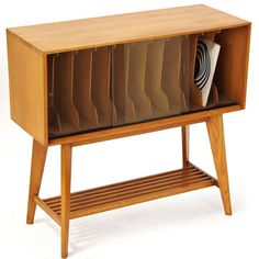 1950s record album storage unit in beautiful blond wood https://emfurn.com/collections/dining-chairs