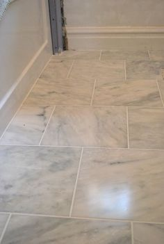 """Grecian white"" marble tile at Home Depot at $3.99/square foot."