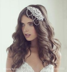 Enhance your bridal look with this stunning handcrafted vintage inspired headpiece. This silver-tone headpiece is expertly shaped to be worn on the left side and is delicately embellished with shimmering Swarovski crystals, pearls and lined with lace.