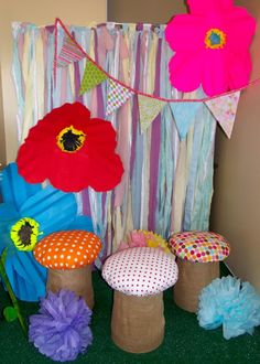 We made a fairy land photo booth in our entry way.  Huge flowers, banner, and mushrooms made from 5 gallon buckets for the kiddos to sit on.