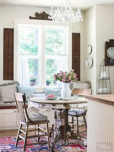 With the right supporting players, even the humblest items can sprout into signature English cottage designs. Here, an antique pedestal table with peeling paint becomes an object of intrigue. Everything else -- the beaded-board, shutters and even the slouchy banquette cushions -- nods to the table's texture without overpowering it.