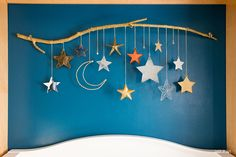 DIY Baby Mobile with Stars and Moon by Make your own DIY baby mobile using star ornaments, chain, and a tree branch. Perfect for a baby girl or baby boy nursery. - DIY Baby Mobile with Stars and Moon Crafts To Make, Crafts For Kids, Diy Crafts, Decoraciones Ramadan, Decoration Creche, Ramadan Crafts, Baby Mobile, Star Ornament, Space Theme