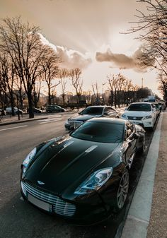 Aston Martin One-77 ..nice car but that sun in the background is awesome!
