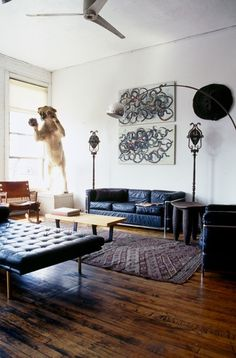 Interior with Corbusier sofa in strange combination with taxidermy