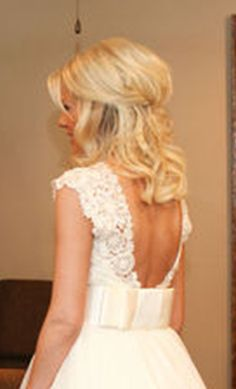 half-up wedding hair. I like how low the pieces are pulled back