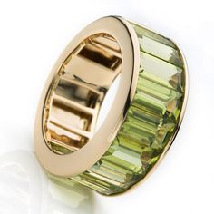 Peridot is one of the few gemstones that occur in one color: olive-green. See this amazing Peridot Diamond Ring for him or her by CARLOS UDOZZO.