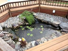 A pond doesn't need to be big to be great! I love this one placed in the middle of the homeowner's deck.