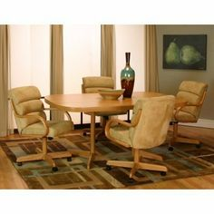 Cramco Mansion 5-Piece Castered Dining Set by Cramco Inc. $1249.99. Feel like a million bucks in the traditional comfort of the Cramco Mansion 5-Piece Rustic Oak Castered Dining Set. The rounded-edge rectangular tabletop is supported by two pedestals for stability. The tan microsuede and oak tilt-swivel chairs will have you planning long dinners just to enjoy the comfort. Ideal arm chairs on caster wheels. Coziness and maximum relaxation await. Choose table option...