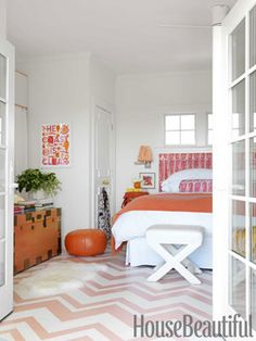 Pattern painted on the floor. Design: Mona Ross Berman. Photo: Jonny Valiant. housebeautiful.com. #bedroom #orange #painted_floor #zigzag_pattern