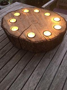 Foto: Schijf van een boomstam, leuk sfeerlicht op de tuintafel!. Geplaatst door Peted01 op Welke.nl