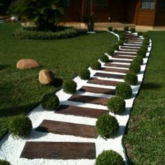 31 Great Front Walkway Ideas You Will Want To Implement Now!- 31 Great Front Walkway Ideas You Will Want To Implement Now! for 2019 – A Nest With A Yard Grass and shrubs create the perfect border to a walkway made of pallet wood and white pebbles - Cheap Landscaping Ideas, Small Front Yard Landscaping, Garden Landscaping, Walkway Ideas, Backyard Walkway, Front Yard Walkway, Backyard Ideas, Wooded Backyard Landscape, Railroad Ties Landscaping
