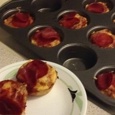 Mini Deep Dish Pizzas 1 1/2 cups Bisquick 1/3 cup very hot water Pizza sauce Cheese Pepperoni  Pre-heat oven to 450. Spray cupcake pan with Cooking spray. Mix Bisquick and water until dough forms. Place small amount of dough into cupcake pan just enough to cover the bottom. Take one spoonful of pizza sauce and place onto dough. Top with your favorite topping. Bake 10-12 minutes.