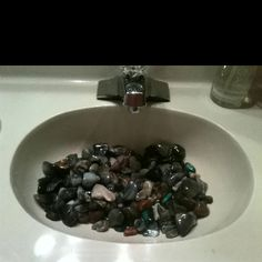Polished Rocks In Bathroom Sink For Easy And Natural Looking Flair