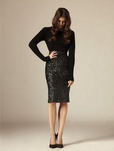 Black sequin skirt and black long sleeve.