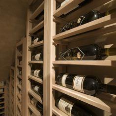 Solid horizontal display row single deep wine racks. See more custom wine racks  here http://www.winecellarspec.com/spec-series-wine-racks/.