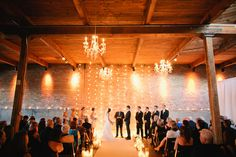 Our wedding!  Candles, Chandeliers, Strands of Lights - Can't get more romantic! On SMP: http://www.stylemepretty.com/illinois-weddings/2013/11/12/goose-island-wedding-at-gallery-1028-from-tim-tab-studios | Photography: Tim Tab Studios